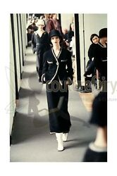 ICONIC CHANEL BOUCLE MONOCHROME SIGNATURE SKIRT SUIT WITH CC LOGO BUTTONS
