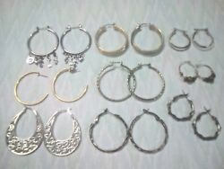 Pierced hoop earrings. Silver tone twisted hoops with charms gold tone +
