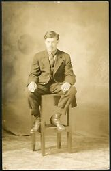HANDSOME MAN in CASUAL POSE  LEGS SPREAD on STOOL REAL PHOTO POSTCARD GAY INT