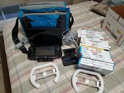 wii u console 21 Games 1 docking station and awesome travel bag to hold system $349.00