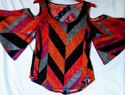 unbranded ladies metalic top with cut out shoulders and short flutter sleeves $29.99