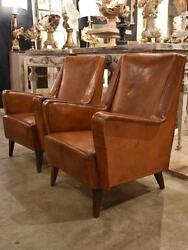 Pair of petite 1960's leather French armchairs - mid century club chairs