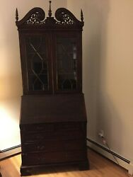 DROP FRONT SECRETARY DESK AND HUTCH WITH GLASS DOORS $300.00