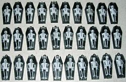 30 Mini Black Coffins With Skeletons $10.00