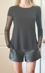 bcbgmaxazria Black jersey top With see through sleeve Size S $175 $40.00