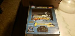 Skyscrambler wireless remote helicopter with 2 parachute men $8.00