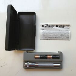 Mini MagLite Flashlight In Case with Two New Batteries. Silver. VERY GOOD. $24.99