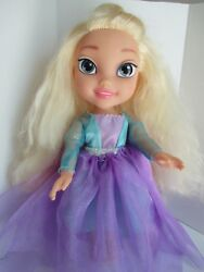 Frozen doll gorgeous platinum hair she wears an extra over skirt