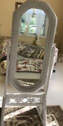 Adjustable floor mirror in white wicker. Perfect for the little girls room.