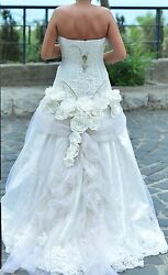 Preowned St. Pucchi 9301 strapless wedding dress color ivory  off white