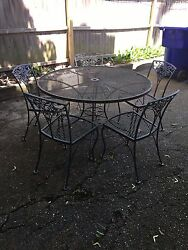 Vintage Wrought Iron Outdoor Dining Table and Chairs