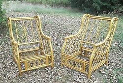 A VINTAGE PAIR OF MID CENTURY RATTAN  WING CHAIRS
