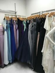 Lot of 129 wholesale bridal dresses and two wedding dresses.