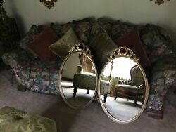 Pair of Bow Top Oval Wall Mirrors $200.00