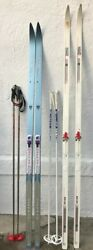 2 pairs of cross country skis with pols and a case boots and bindings $219.99