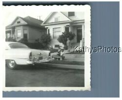 FOUND B&W PHOTO H_6436 BOY IN PEDAL CAR, WOMAN IN FRONT OF HOUSE, CAR $6.98