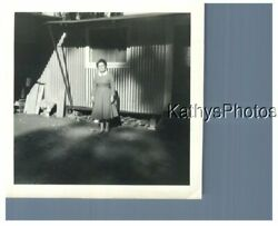 FOUND B&W PHOTO H_6428 WOMAN STANDING IN FRONT OF A HOUSE $6.98