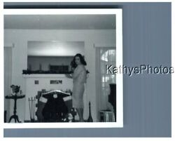 FOUND B&W PHOTO H_6444 CHRISTMAS, WOMAN AND STOCKINGS HUNG AT FIRE PLACE $6.98