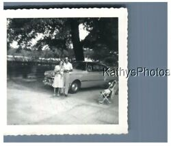 FOUND B&W PHOTO H_6411 MAN, WOMAN AND BABY IN FRONT OF A CAR $6.98