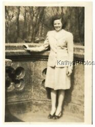 FOUND Bamp;W PHOTO G 9376 YOUNG WOMAN STANDING IN FRONT OF A WALL TREES IN BACK $6.98