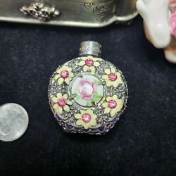 Vintage glass perfume bottle with decorated hand painted center and pink crysta $36.00
