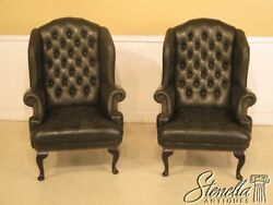 43257E: Pair Tufted Green Leather Chesterfield Style Wing Chairs