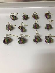 12 CHRISTMAS ORNAMENTS MADE WITH BLING PURPLE GREEN AND GOLD MARDI GRAS COLORS $15.00