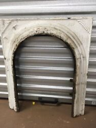 ANTIQUE CAST IRON FIREPLACE SURROUND ARCHED WITH FAN DESIGN