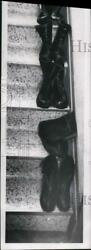 1963 Press Photo Wynne family stairs with boots at the end of the day.