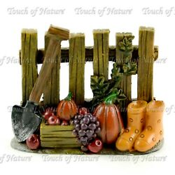 Fall Fence w Wellies Shovel  and Fruit 2