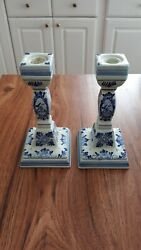 TWO BLUE AND WHITE CANDLE HOLDERS $25.00