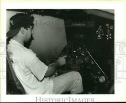 1994 Press Photo Brad Turnage Tries Helicopter Simulator in Army Adventure Van $17.88