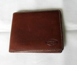 A mens wallet name brand Fossil
