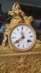 Antique French 8 day time and strike spring brass movement with silk thread.