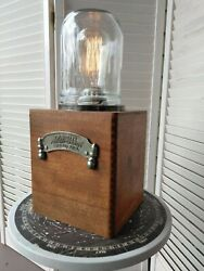Custom lamp with old metal plumbing sign from Loveland Co and Edison bulb $55.00
