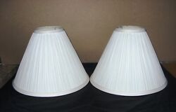 Pair of white pleated lampshades for small lamps. Purchased new never used. $22.00