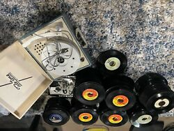 vintage 45 used portable player hundreds of records that work and some do not $250.00