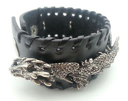 Adjustable Button Leather Bracelet with a Flexible Metal Dragon Design $13.99