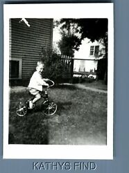 BLACK & WHITE PHOTO P_5215 SIDE VIEW OF LITTLE BOY SITTING ON TRICYCLE