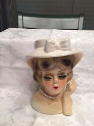 Head Vase Lady she is wearing a  ivory dress with hat and white pearls