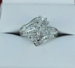 Woman's Diamond Flower Cluster Round Cut Diamond Engagement Ring