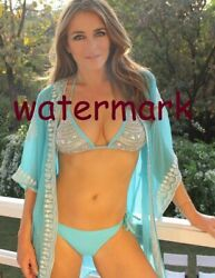 ELIZABETH HURLEY ACTRESS AND MODEL IN BLUE BIKINI AND ROBE PUBLICITY PHOTO $9.89