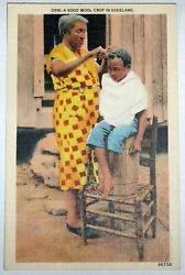 antique postcard of a black child getting a haircut