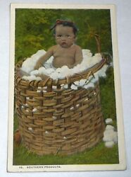 antique postcard of a black baby in a basket of wool