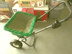 Lawn fertilizer spreader color green in perfect condition $45.00
