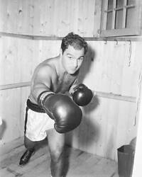 World Heavyweight Champion Rocky Marciano Punches OLD BOXING PHOTO AU $8.50