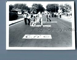 BLACK amp; WHITE PHOTO I1153 MAN RUNNING IN STREET OVER LARGE SIGNS $3.98