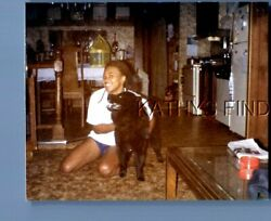 FOUND COLOR PHOTO H4989 PRETTY BLACK WOMAN SITTING ON FLOOR WITH DOG $6.98