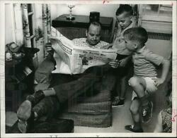 1963 Press Photo Paul Haney reads the paper as sons Dan amp; Michael look on. $13.99