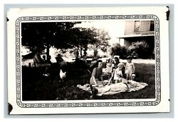 Vintage 1944 Photograph Family in Their Backyard Suburban Home Chickens FUNNY $17.97